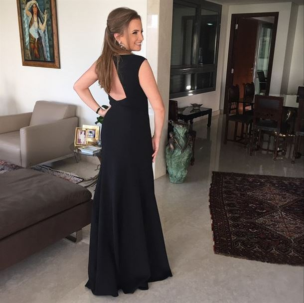 Tania Kassis in a long black dress