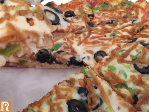 سعر البيتزا الوسط 1.250 دينار