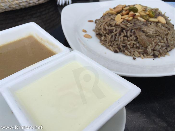Kharouf Mehchi with sauce and yogurt