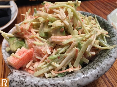 Salad contains Salmon, crabstick, avocado, cucumber, iceberg and spicy mayonnaise