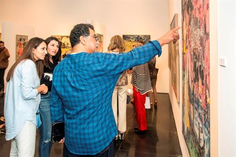 Mohamed Abla explains one of his paintings to the audience