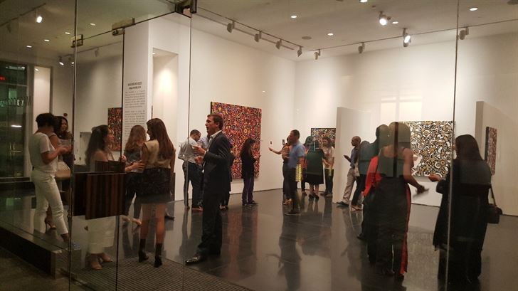 "Guests at the opening of ""Measure and Excess"" from the work of Hiba Khamlichi in ARTSPACE"