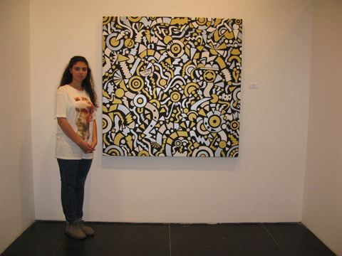Hiba Khamlichi and one of her paintings