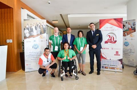 Yasser Moussa - Executive Assistant Manager along with the Gold winner at the 9th Fazza Para Powerlifting Games 2018 - Brittany and her coach at the Al Bustan Center & Residence Hotel Lobby.